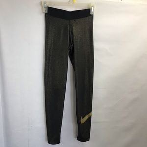 Nike black and gold dust XS tights
